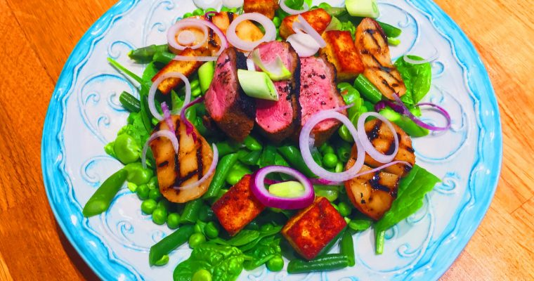 Indian dry spiced crispy duck breast with char-grilled peach, crusted paneer and hot green salad of spinach, peas, asparagus and beans | National Dish India